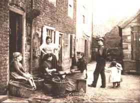 'Girls Skaning Mussels' by Frank Meadow Sutcliffe