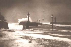 `High Seas on Whitby's West Pier' by Frank Meadow Sutcliffe