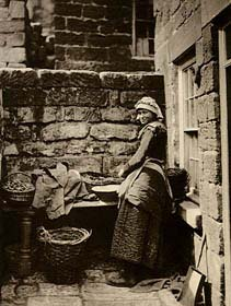 `Girl Baiting Lines, Shop Alley, Runswick Bay' by Frank Meadow Sutcliffe